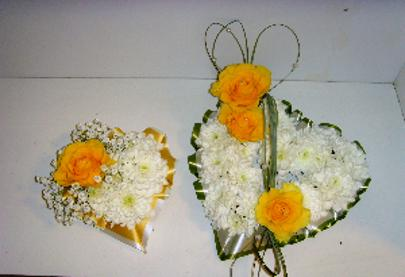 Funeral Hearth Wreaths with yellow roses