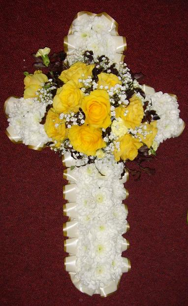 Funeral flowers cross wreath with yellow spray