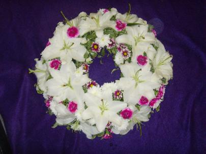 Circular funeral wreath of lillies