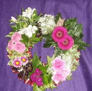 Circular textured funeral wreath at kays flower school