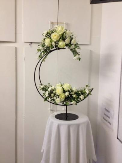 Curved Church arrangement of white roses